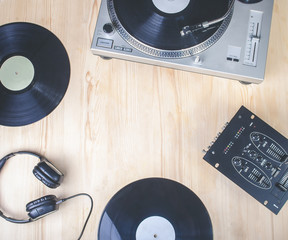 top view of music player equipment on wooden desk