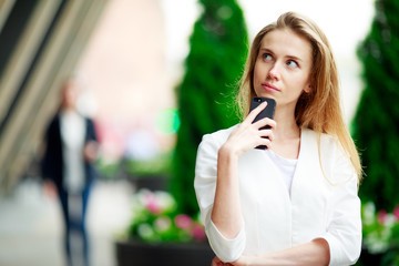 Beautiful casual woman with cell phone