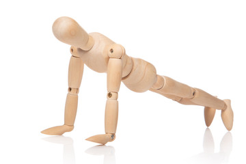 Small wooden dummy during push ups