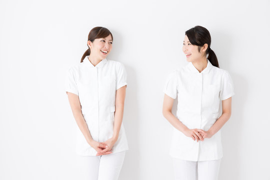 young asian nurse isolated on white background