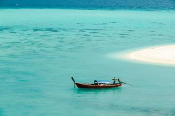 One alone boat in blue sea.