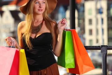 Stylish shopper woman in old town Gdansk
