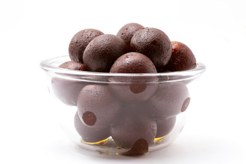 Gulab Jamun in a Glass Bowl  - An Indian sweet dish, round shaped, black or brown texture served after meals directly or with ice cream
