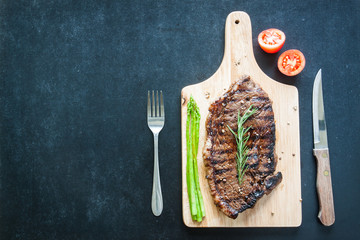grilled fillet steak with asparagus and tomato ready to served