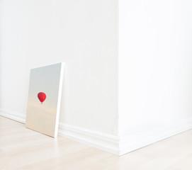 Empty room interior with art on floor