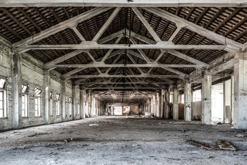 Acrylic Prints Industrial building Empty industrial loft in an architectural background with bare cement walls, floors and pillars supporting a mezzanine