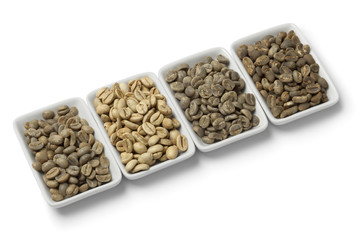 Four kinds of green unroasted coffee beans