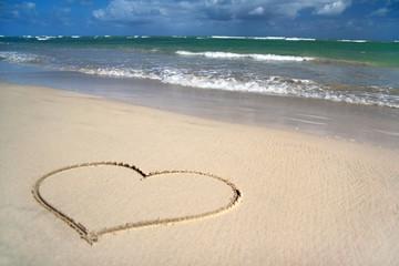 Valentines heart on sand of beach