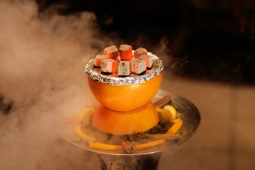 Asian, arabia hookah with charcoal. Smoke