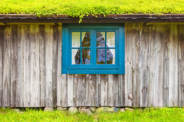 Ancient Swedish wooden farmhouse with blue window