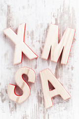 decorative wooden letters xmas on a white background, top view