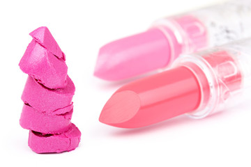 Sliced lipstick isolated on white