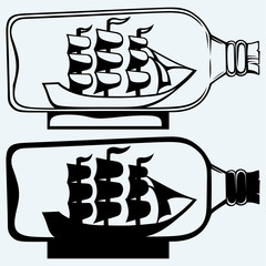 Old sailboat in glass bottle. Isolated on blue background