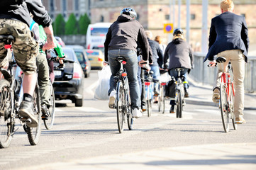 Bicyclists in traffic Wall mural