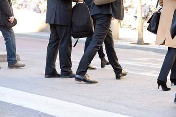 Business dressed men on zebra crossing