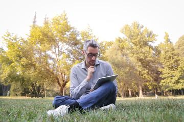 Man reading at the park