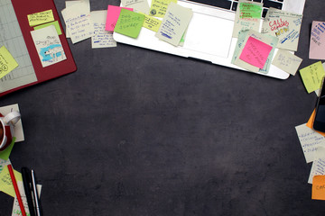 Office workspace covered by post it papers