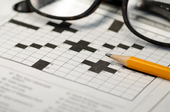 Cross word puzzle pencil and glasses