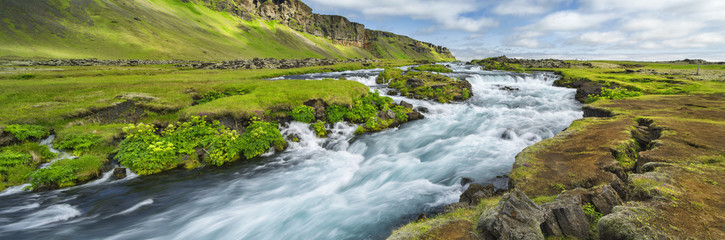 Tuinposter Rivier Power river with strong current in Iceland