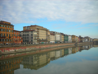 Beautiful renaissance architecture of Pisa on the banks of river Arno on a sunny, tranquil morning. Italy, Tuscany.