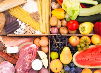 Fruits, vegetables, meat, fish and pasta in separate boxes