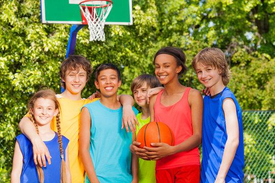 International friends stand after basketball game