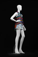 full-length mannequin female dressed in shirt and short on black background