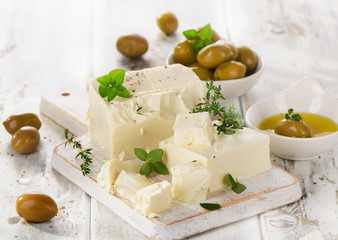 Feta cheese with green olives and herbs.