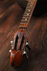 Folk musical instrument domra on wooden background