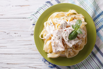 alfredo pasta in cream sauce with chicken. horizontal  top view