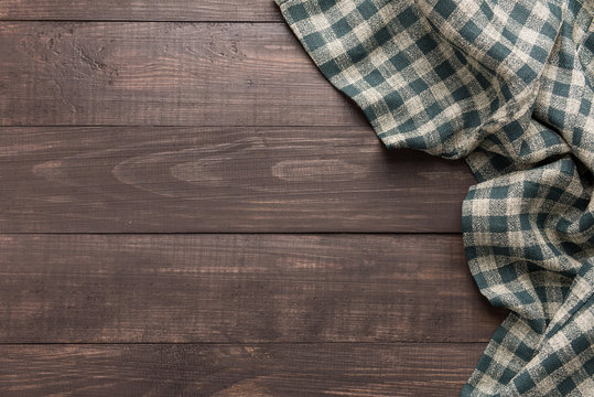 Napkin on the wooden background. Top view