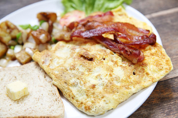 Breakfast with bacon , fried egg and bread