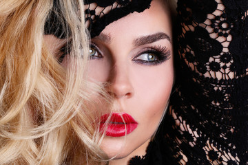 Portrait of a beautiful blond woman very with green eyes of sweet red lips in a sensual hairstyle with a sexy look and sexy makeup