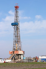 land oil drilling rig with equipment on oilfield