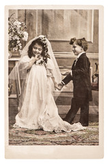 Vinatge photo portrait of little girl and boy in weding dressing