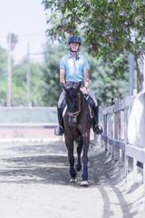 young man riding a horse.