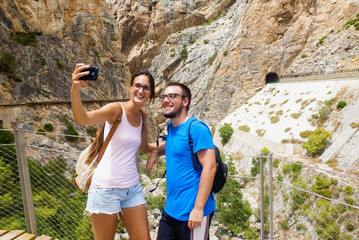 Young couple taking a selfie in mountainous place