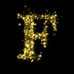Sparkling letter F of glittering stars bokeh