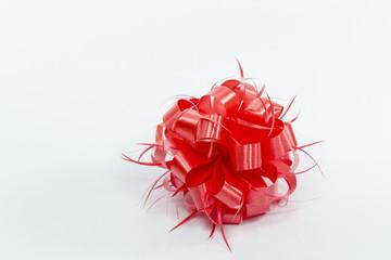 sphere shape handmade ribbon flower on white background, red