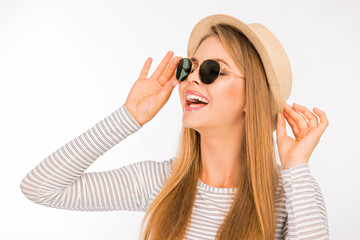 pretty girl in a hat and sunglasses laughing