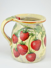 Decoupage decorated strawberry pattern pitcher on white