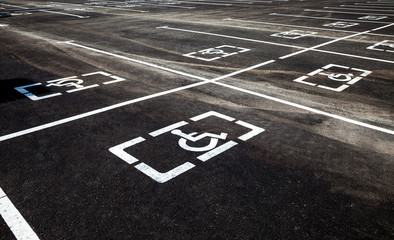 Parking places with handicapped or disabled signs and marking li