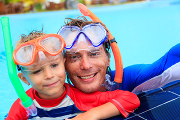 happy father and son snorkeling making selife