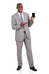 young african businessman presenting smart phone