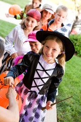 Halloween: Children Lined Up for Halloween Candy