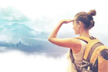 Woman traveler looking at Batur volcano. Indonesia Wall mural