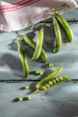 top view, pea pods on wooden background