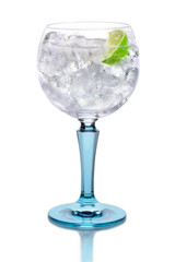 Glass with gin, tonic, lime and ice