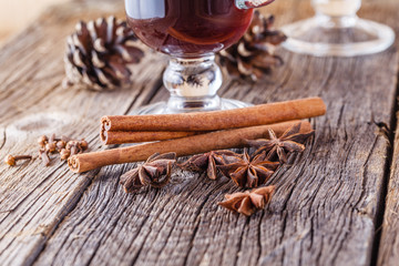 Mulled wine recipe, spices on wooden background