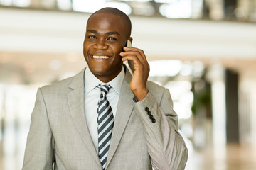 young black businessman talking on cell phone